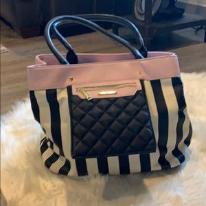 Betsey Johnson pink and white black stripe purse.